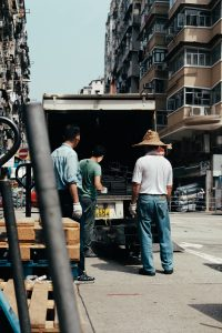 Three men unloading a truck