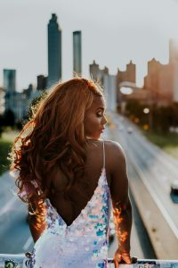 African-American woman in a gown, with the highway in the background.