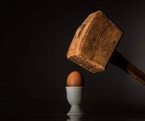 A hammer breaking an egg - you don't want fragile items broken.