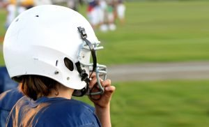 Image of a boy wearing football protective gear