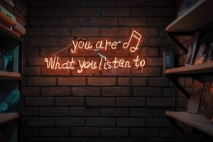 """You are what you listen to"" neon sign"