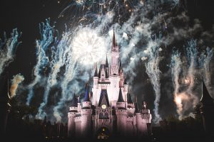 Disney castle with fireworks in the background