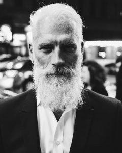 A handsome senior citizen with a long beard