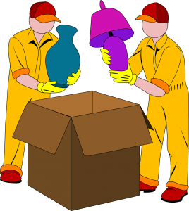 Movers putting items in a box.