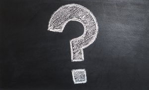 A question mark on a blackboard.