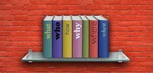 Books with questions pronouns on a shelf