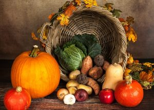 The best places to spend Thanksgiving usually have a basket full of vegetables and other tasty food.