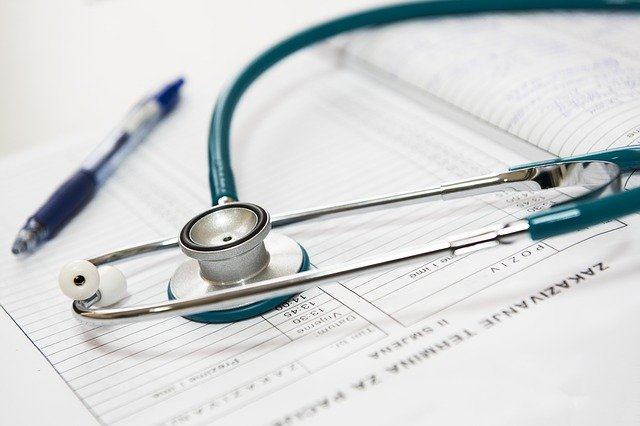 Stethoscope on medical reports.