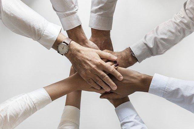 Close up of hands representing teamwork.