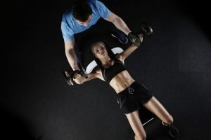 Girl working out with a personal trainer