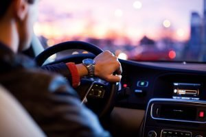 Close-up of a person driving.