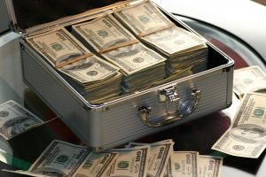 A metal suitcase filled with money
