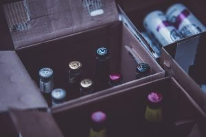 Learn how to pack items for shipping, like this box of glass bottles