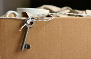 Cardboard box, key and cup
