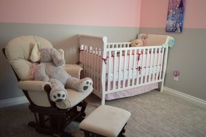 A nursery with toys, chair and baby cot is something cross country movers Minnesota will move for you