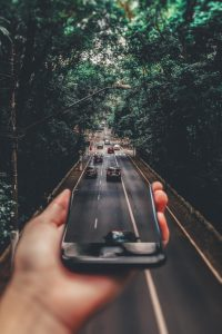 long distance movers - the road with cars and trees, mobile phone