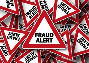 Road sign Fraud alert