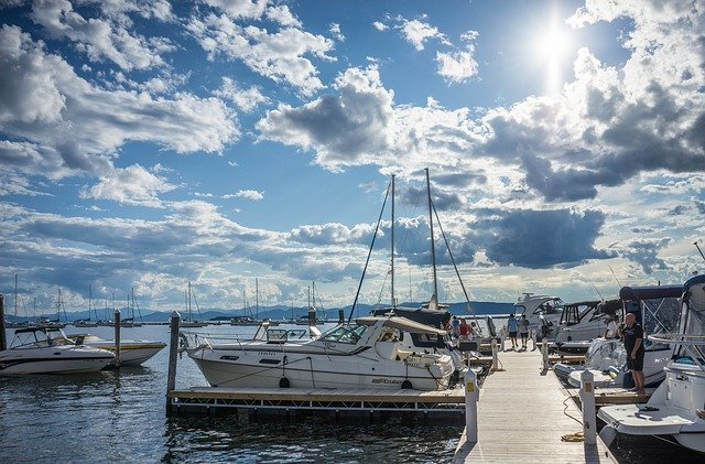 Lake, pier, boats and blue sky