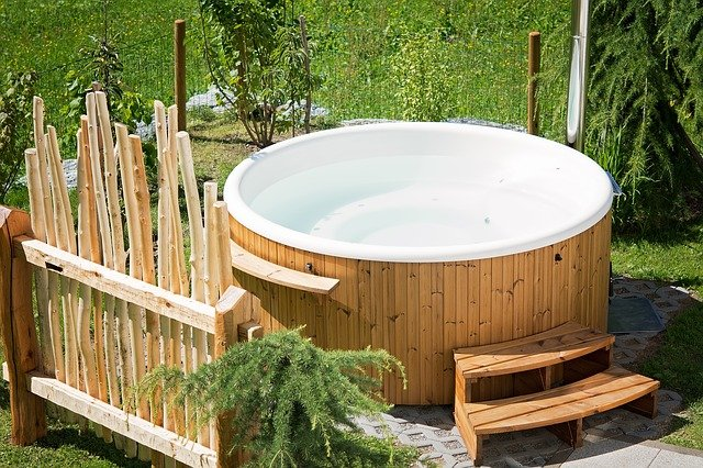 A drained hot tub - prepare a hot tub for moving before trying to move it.