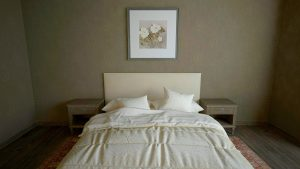 Bed and a painting above it