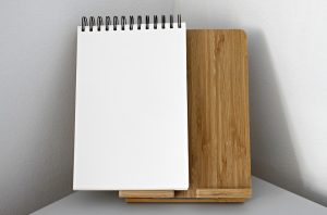 An empty notebook to write down the risks of moving your business.