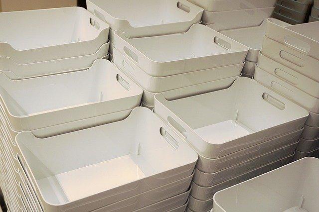 Stacks of plastic bins
