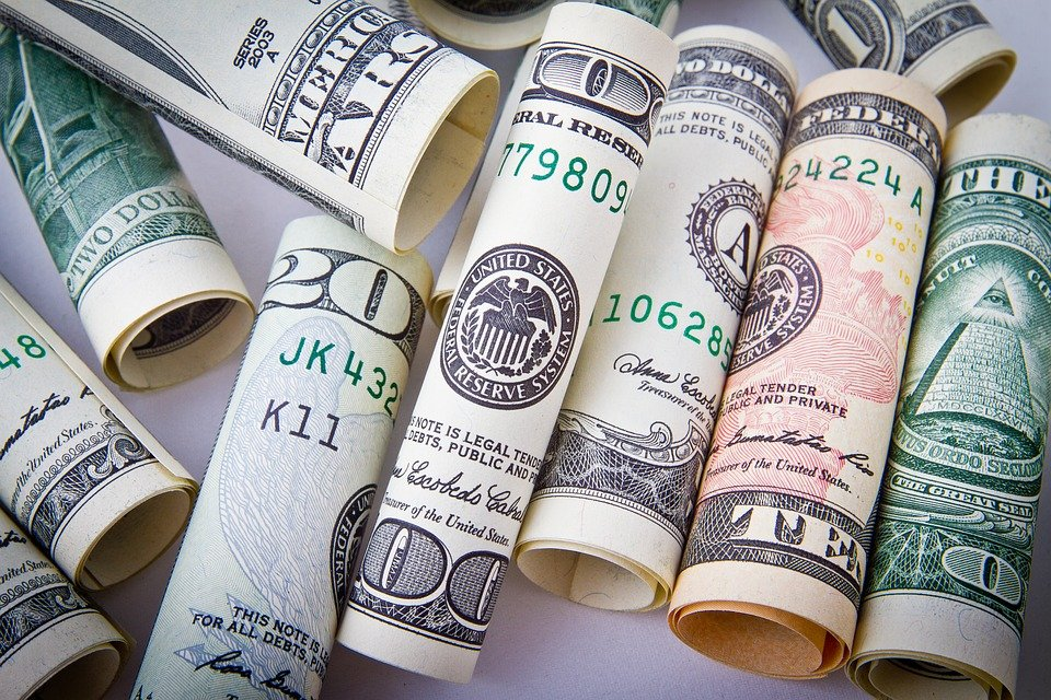 Rolled up dollar bills.