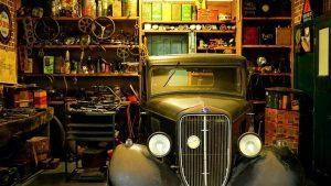 A vintage car in a garage.