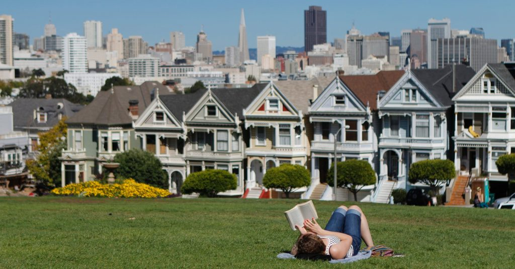 woman on the grass reading
