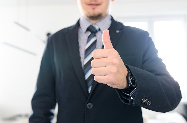 Satisfied worker showing thumbs up