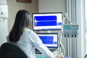 Woman looking at the monitor of the medical device