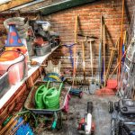 Garden shed with different tools. Here are tips for packing gardening equipment