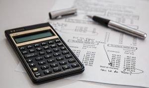 calculator and paper with information