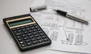calculator, pan and paper