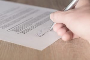 A person not reading a contract as one of the Most common interstate moving mistakes
