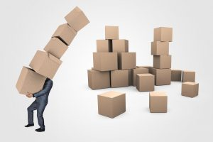 man hodling cardboard boxes