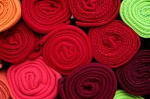 Rolled red fabrics and piled up