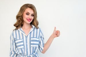 a woman showing thumbs up