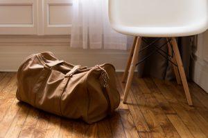 a travel bag on the floor