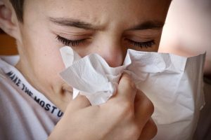 A boy being sick, can't prepare for the move as one of the Downsides of moving while sick