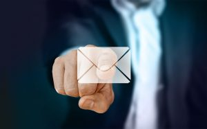 a man pointing out an email icon
