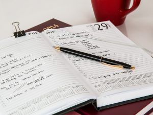 A notebook with a plan about relocating a small business