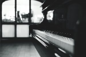 a black piano inside the room