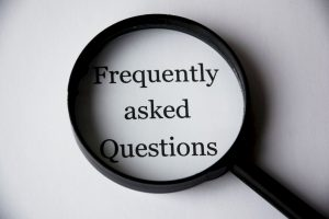 a photo of the sign frequently asked questions under a loop. There are a lot of questions that you should answer to decide whether you want to relocate for a job