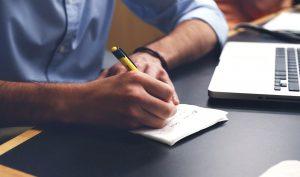 man writing a plan