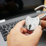 man holding a lock