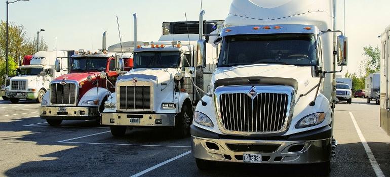 A cross country movers Nebraska truck fleet on a parking lot