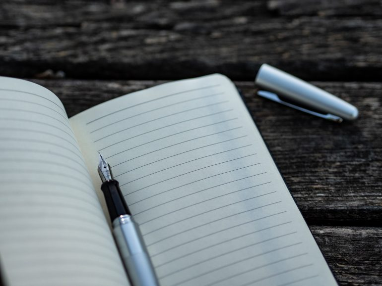 A notebook and a pen