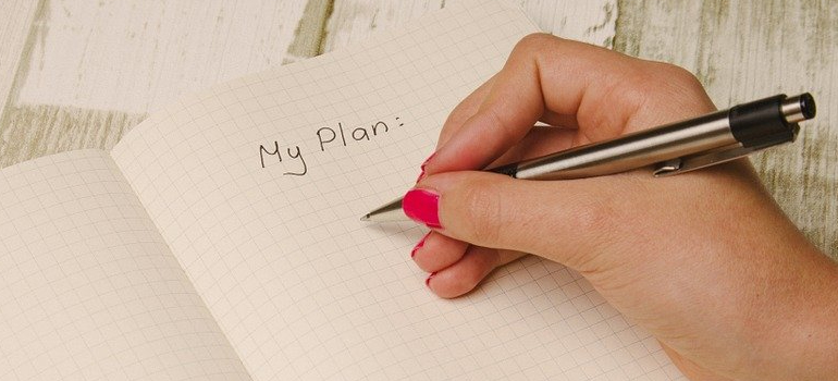 a hand writing a plan