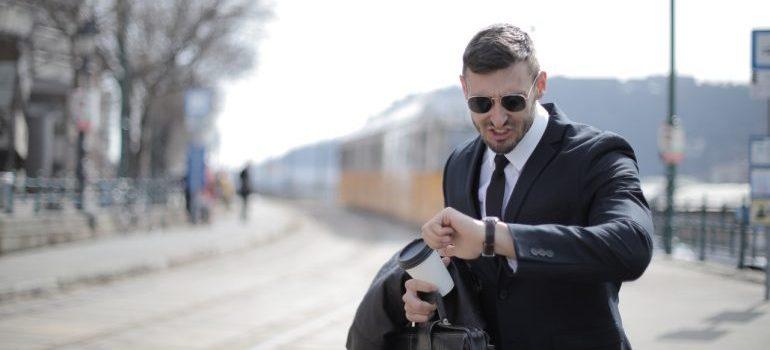 Agitated man looking at his watch.